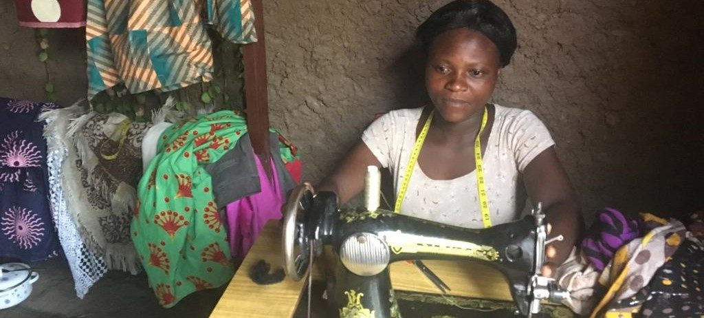 //wwkisoboka.org/wp-content/uploads/2019/12/BF_Mrs-Itungu-Esther-is-practicing-tailoring-Banner.jpg